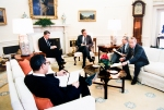 Meeting with President Reagan, Vice President Bush, Deputy National Security Adviser Frank Carlucci and General Colin Powell in the Oval Office.